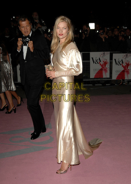 KATE MOSS, MARIO TESTINO.V&A Golden Age of Couture Gala.Victoria and Albert museum.18th September 2007 London, England.full length gold cream silk satin vintage puff long sleeved dress ope-toe shoes purse clutch bag behind camera taking photo.CAP/PL.©Phil Loftus/Capital Pictures