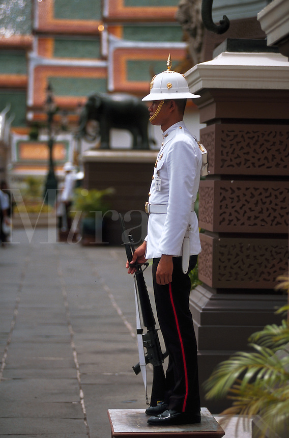 A guard at the steps to the Grand Palace in Bangkok, Thailand
