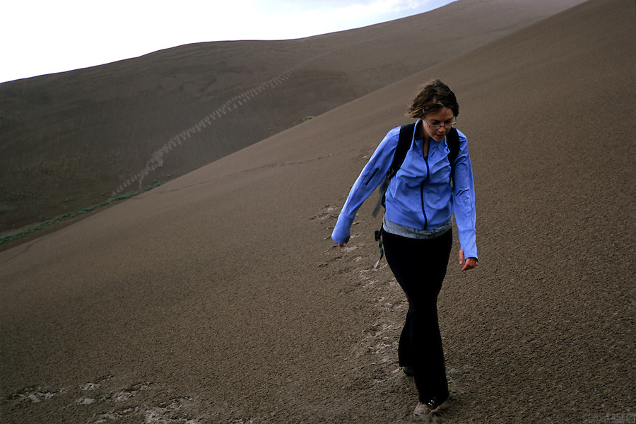 Crossing the wind swept dunes of Great Sand Dunes National Park, in the San Luis Valley of Colorado.