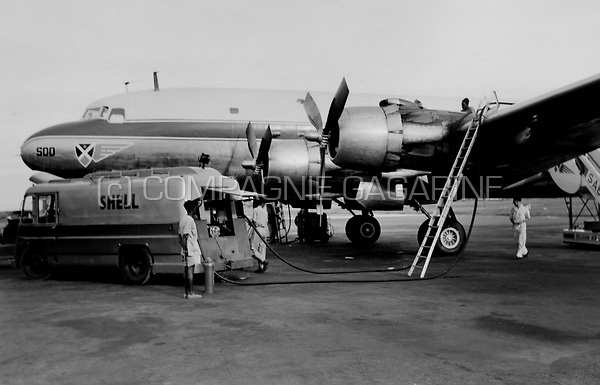 A Douglas DC-4 Sabena airplane on the tarmac in Congo (1954)