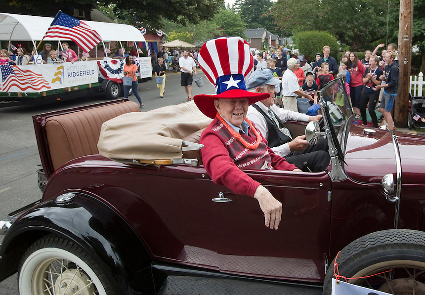 2016 Parade Grand Master, John Burrows, who turns 101 tomorrow, takes part in the Fourth of July Parade through the town of Ridgefield Monday July 4, 2016. (Photo by Natalie Behring/ for the The Columbian)