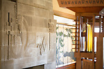 Textures of the bas reief over the fireplace and Frank Lloyd Wright's custom deigned wood furniture with an 18th century Japanese screen added later at Aline Barnsdall's  Hollyhock House in Barnsdall Art Park, Hollywood, Los Angeles, CA