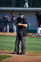 Home plate umpire Casey James during a Pioneer League game against the Great Falls Voyagers at Centene Stadium at Legion Park on August 19, 2019 in Great Falls, Montana. Missoula defeated Great Falls 4-1 in the first game of a doubleheader. Games were moved from Missoula after Ogren Park at Allegiance Field, the Osprey's home field, was ruled unplayable. (Zachary Lucy/Four Seam Images)
