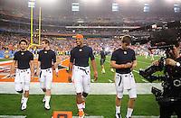 Jan 10, 2011; Glendale, AZ, USA; Auburn Tigers quarterback Cameron Newton (center) walks back to the locker room before the 2011 BCS National Championship game against the Oregon Ducks at University of Phoenix Stadium.  Mandatory Credit: Mark J. Rebilas-