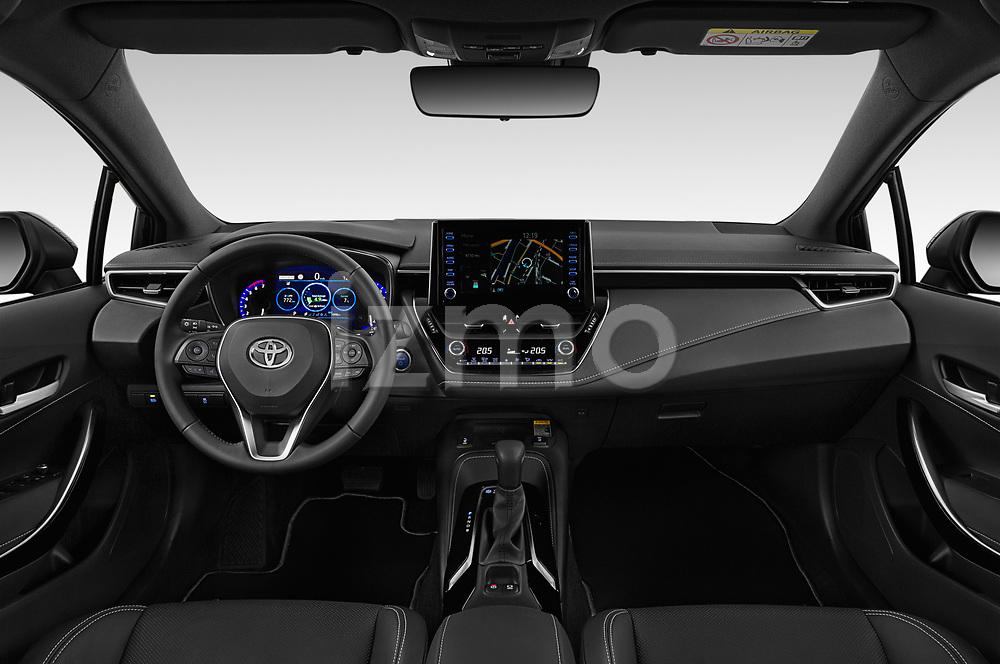 Stock photo of straight dashboard view of 2019 Toyota Corolla-Hybrid Premium 5 Door Hatchback Dashboard