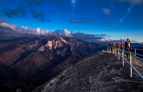 Tourist enjoy the views at sunset from Moro Rock at Sequoia National Park, California