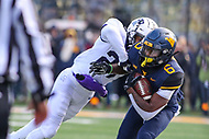 Morgantown, WV - November 10, 2018: West Virginia Mountaineers running back Kennedy McKoy (6) is pushed out of bounds during the game between TCU and WVU at  Mountaineer Field at Milan Puskar Stadium in Morgantown, WV.  (Photo by Elliott Brown/Media Images International)