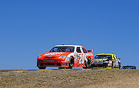 Jun. 21, 2009; Sonoma, CA, USA; NASCAR Sprint Cup Series driver Joey Logano (20) leads A.J. Allmendinger during the SaveMart 350 at Infineon Raceway. Mandatory Credit: Mark J. Rebilas-