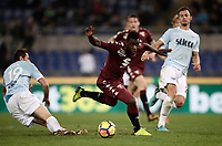 Calcio, Serie A: Roma, stadio Olimpico, 11 dicembre 2017.<br /> Torino's Afriyie Acquah (r) in action with Lazio's Senad Lulic (l) during the Italian Serie A football match between Lazio and Torino at Rome's Olympic stadium, December 11, 2017.<br /> UPDATE IMAGES PRESS/Isabella Bonotto