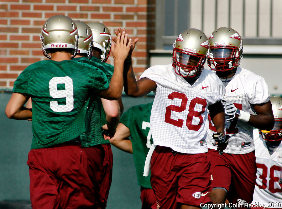 TALLAHASSEE, FL 8/5/10 FSU 080510 CH-Florida State's Clint Trickett, left, high fives with Dionte Allen during the first day of practice Thursday in Tallahassee. .COLIN HACKLEY PHOTO