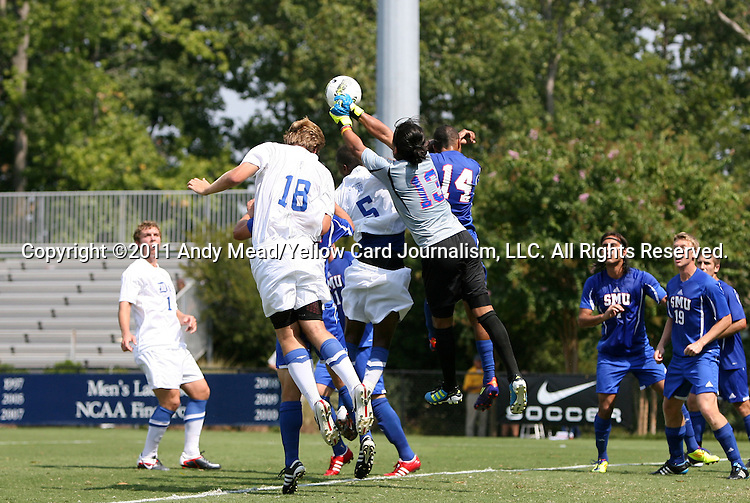 04 September 2011: SMU's Jaime Ibarra (13) punches the ball away from Duke's Nat Eggleston (18) and Sebastien Ibeagha (5) and SMU's Aaron Simmons (14). The Southern Methodist University Mustangs defeated the Duke University Blue Devils 1-0 in overtime at Koskinen Stadium in Durham, North Carolina in an NCAA Division I Men's Soccer game.