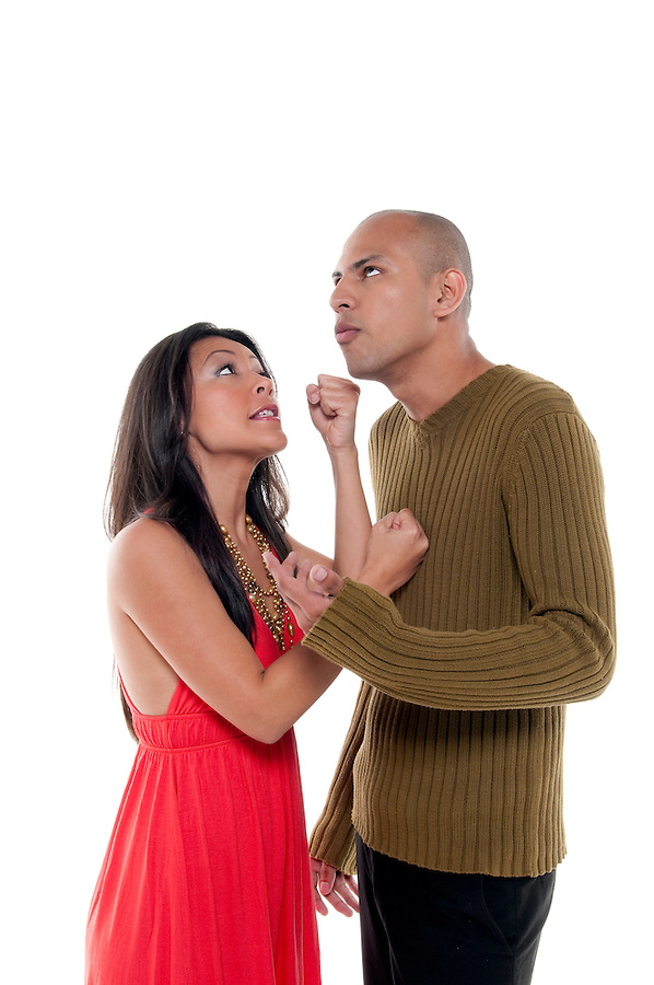 Young couple having an argue very stressed and fighting.