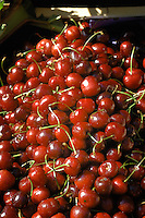 Red cherries on display in fruit market. Viktualienmarkt, Munich, Germany.