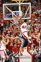 Wisconsin's Alando Tucker tries for a dunk over Penn State's Danny Morrissey, as the Badgers top the Nittany Lions 75-49 on Saturday at the Kohl Center in Madison