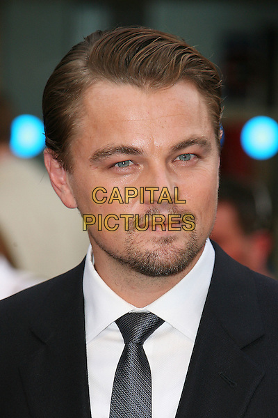 LEONARDO DiCAPRIO .World Premiere of 'Inception' at the Odeon Leicester Square, London, England, UK, July 8th 2010..arrivals portrait headshot black shirt tie facial hair goatee beard white leo di caprio .CAP/DAR.©Darwin/Capital Pictures.
