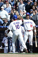 Miguel Tejada & Moises Alou of the Dominican Republic during semi final game against Cuba during the World Baseball Championships at Petco Park in San Diego,California on March 18, 2006. Photo by Larry Goren/Four Seam Images