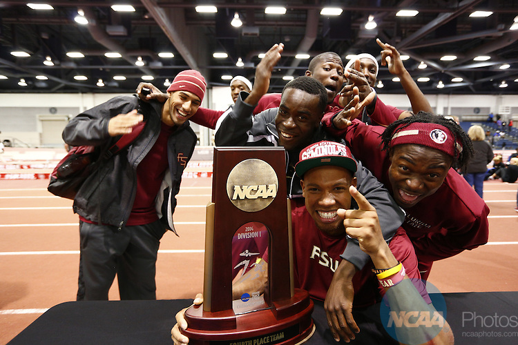 15 MAR 2014: A team celebrates during the Division I Men's and Women's Indoor Track and Field Championships held at the Albuquerque Convention Center Saturday, March 15, 2014 in Albuquerque, New Mexico. (Juan Antonio Labreche/NCAA Photos)