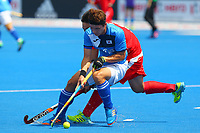 Korea's lee Seunghoon holds up the ball fron China's Su Jun during the Hockey World League Semi-Final Pool A match between China and Korea at the Olympic Park, London, England on 17 June 2017. Photo by Steve McCarthy.