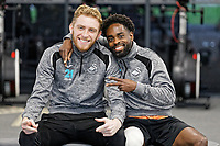 (L-R) Oli McBurnie and Nathan Dyer smile for the camera during the Swansea City Training Session at The Fairwood Training Ground, in Swansea, Wales, UK. Wednesday 06 March 2019