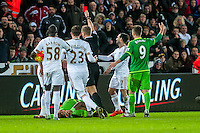 Kyle Naughton of Swansea receives a red card from Referee Graham Scott during the Barclays Premier League match between Swansea City and Sunderland played at the Liberty Stadium, Swansea  on  January the 13th 2016