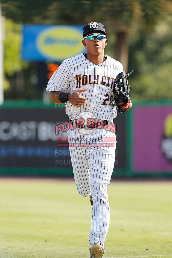 "Charleston Riverdogs outfielder Leonardo Molina (20) running into the dugout during a game against the Hickory Crawdads at the Joseph P. Riley Ballpark in Charleston, South Carolina. For Sunday games, the Riverdogs wear their ""Holy City"" uniforms in honor of the city's nickname. Hickory defeated Charleston 8-7. (Robert Gurganus/Four Seam Images)"