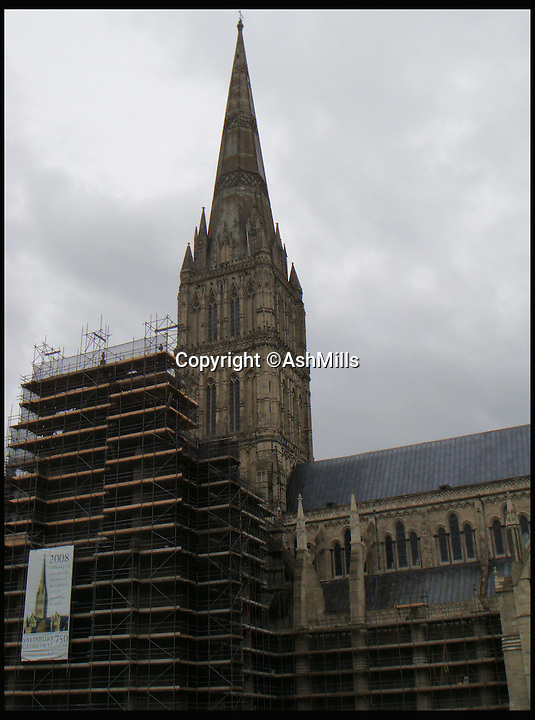 BNPS.co.uk (01202 558833)<br /> Pic: AshMills/BNPS<br /> <br /> ***Please Use Full Byline***<br /> <br /> Salisbury cathedral with scaffolding.<br /> <br /> One of Britain's best known cathedrals is free from scaffolding for the first time in nearly 30 years following a major restoration project. <br /> <br /> Work began on historic Salisbury Cathedral in 1986 amid concerns that the 795-year-old medieval building was falling into disrepair. <br /> <br /> Now, 29 years after the first work began, the cathedral in Wiltshire is free from as the extensive renovation reaches its final stage.<br /> <br /> The removal of the scaffolding also corresponds with the 800th anniversary of the signing of the Magna Carta, the charter King John was forced to comply with in 1215 granting rights to the public and to the church.