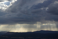 A cloudy summer afternoon seen over the mountains in southern Utah's Dixie Nat. Forest.
