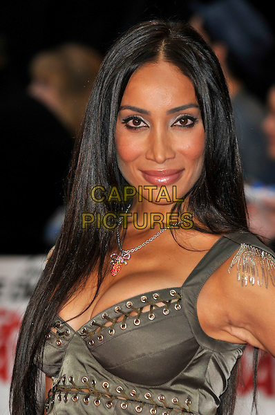 SOFIA HAYAT .'Knight and Day' UK film premiere at the Odeon cinema, Leicester Square, london England 22nd July 2010.portrait headshot grey gray green khaki lace-up rivets cleavage silver necklace .CAP/PL.©Phil Loftus/Capital Pictures.