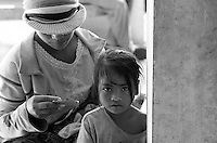 Health center in Cambodia. A young girl is waiting for his mother at Trapeng Andeuk health center. Trapeng Andeuk, Takeo province, Cambodia-2009