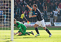 Dundee's Peter MacDonald celebrates after he scores their first goal.