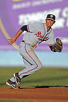 Rome Braves shortstop Jose Peraza #4 makes a play during a game against the Asheville Tourists at McCormick Field on May 23, 2013 in Asheville, North Carolina. The Braves won the game 6-1. (Tony Farlow/Four Seam Images).