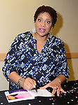 DAVIE, FL - MARCH 18: Actress and Comedian Kim Coles speaks and sign copies of her book 'Gratitude Journal Choose to Live Life Out Loud' to discuss her story of gratitude, Intention, forgiveness, triumphs and self-love in the library at Broward College on March 18, 2014 in Davie, Florida. The lecture is titled 'Love and Laughter: Identity, Acceptance, and the Female World of Comedy.' (Photo by Johnny Louis/jlnphotography.com)