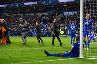 Sol Bamba of Cardiff City looks dejected as Wolves players celebrate at full time of the Sky Bet Championship match between Cardiff City and Wolverhampton Wanderers at the Cardiff City Stadium, Cardiff, Wales on 6 April 2018. Photo by Mark  Hawkins / PRiME Media Images.