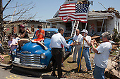 """May 29, 2011.""""The President visited Joplin, Missouri, following a devastating tornado. Here he greets Hugh Hills, 85, in front of his home. Hills told the President he hid in a closet during the tornado, which destroyed the second floor and half the first floor of his house."""".Mandatory Credit: Pete Souza - White House via CNP"""