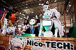 "A SoftBank robot Pepper performs at the Niconico Douga fan event in Makuhari Messe International Exhibition Hall on April 25, 2015, Chiba, Japan. The event includes special attractions such as J-pop concerts, Sumo and Pro Wrestling matches, cosplay and manga and various robot performances and is broadcast live on via the video-sharing site. Niconico Douga (in English ""Smiley, Smiley Video"") is one of Japan's biggest video community sites where users can upload, view, share videos and write comments directly in real time, creating a sense of a shared watching. According to the organizers more than 200,000 viewers for two days will see the event by internet. The popular event is held in all 11 halls of the huge Makuhari Messe exhibition center from April 25 to 26. (Photo by Rodrigo Reyes Marin/AFLO)"