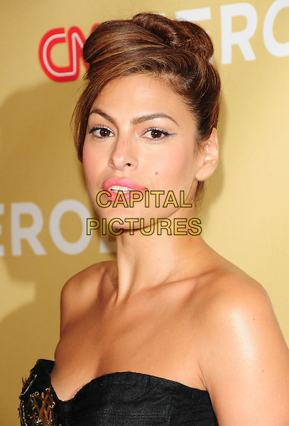 EVA MENDES .at The 3rd Annual CNN Heroes: An All-Star Tribute held at The Kodak Theatre in Hollywood, California, USA,  November 21st 2009                                                                   .portrait headshot strapless black hair up eye contact .CAP/RKE/DVS.©DVS/RockinExposures/Capital Pictures