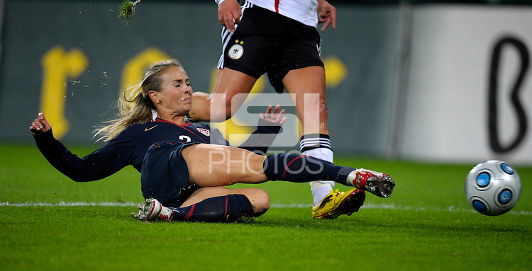 Heather Mitts slide tackles. US Women's National Team defeated Germany 1-0 at Impuls Arena in Augsburg, Germany on October 29, 2009.
