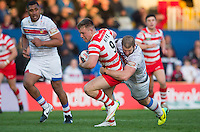 Picture by Allan McKenzie/SWpix.com - 17/04/2015 - Rugby League - Ladbrokes Challenge Cup - Wakefield Trinity Wildcats v Halifax RLFC - Rapid Solicitors Stadium, Wakefield, England - Halifax's Ben Kaye is tackled by Wakefield's Nick Scruton.