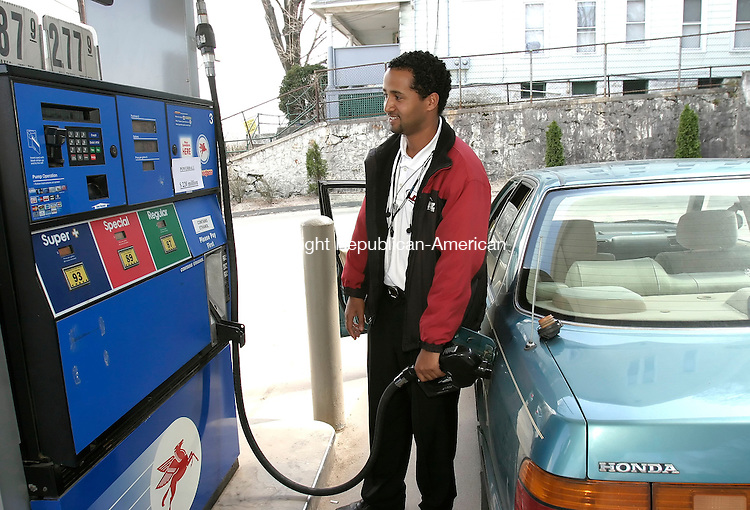 WATERBURY, CT, 11 April 2006- 041106BZ05- Nega Fechisso, of New Haven, gets gas at the Mobil station on Watertown Avenue in Waterbury. <br /> Jamison C. Bazinet Republican-American