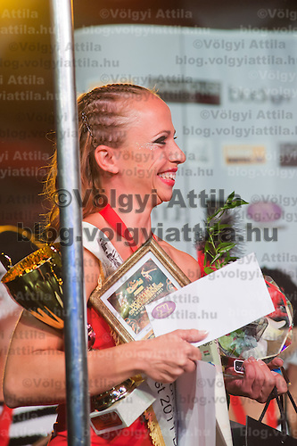Barbara Palmaffy from Hungary celebrate their victory in the doubbles category of the World Pole Sport & Fitness Championships 2011 in Budaors, Hungary on October 01, 2011. ATTILA VOLGYI