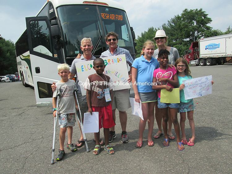 WATERBURY,CT- 06 July 2015- 070615DL01-- The Fuchs-Lancaster family of Washington, left, and the Cogan family of Morris,right, welcome their Fresh Air Fund Campers from New York City. 14 city children arrived in Waterbury Monday to be paired with volunteer host families. Destiny Lopez Republican-American