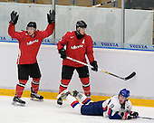 Steve Kellenberger (Kloten Flyers - Switzerland) proclaims his innocence as his stick goes flying over Juraj Simek (Brandon Wheat Kings - Switzerland) and Julius Sinkovic (Val-d'Or - Slovakia) looks for a call. The Suisse defeated Slovakia 2-1 in a 2007 World Juniors match on January 2, 2007, at FM Mattson Arena in Mora, Sweden.