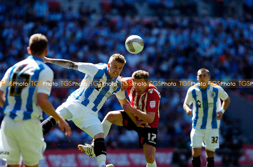 Jack Hunt of Huddersfield Town and Richard Cresswell of Sheffield United- Huddersfield Town vs Sheffield United - nPower League One Promotion Play-Off Final at Wembley Stadium, London - 26/05/12 - MANDATORY CREDIT: Anne-Marie Sanderson/TGSPHOTO - Self billing applies where appropriate - 0845 094 6026 - contact@tgsphoto.co.uk - NO UNPAID USE.