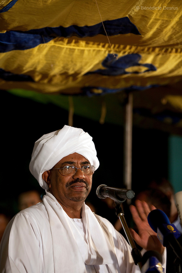 26 april 2010 - NCP party's Khartoum headquarters, Karthoum, Sudan - Sudan's President Omar Hassan al-Bashir addresses the nation after being re-elected at the NCP Headquarters in Khartoum. He wins another term in office, according to election officials, with a comfortable majority in elections marred by boycotts and fraud allegations, becoming the first leader to be elected while facing an international arrest warrant for alleged crimes he orchestrated in the western region of Darfur. The elections take place as Sudan heads toward a referendum in eight months that could lead South Sudan to split off and become Africa's newest nation. Photo credit: Benedicte Desrus