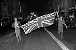 Prince Charles and Lady Diana Spencer Royal Wedding Wednesday 29 July 1981 London. Young people flying the Union Jack Flag in The Strand the night before the wedding. 1980s UK
