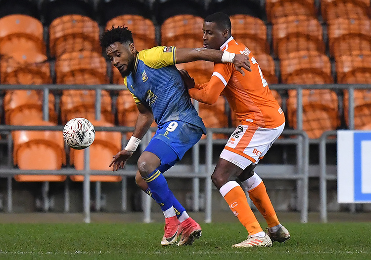 Blackpool's Donervon Daniels battles with Solihull Moors' Adi Yussuf<br /> <br /> Photographer Dave Howarth/CameraSport<br /> <br /> The Emirates FA Cup Second Round Replay - Blackpool v Solihull Moors - Tuesday 18th December 2018 - Bloomfield Road - Blackpool<br />  <br /> World Copyright © 2018 CameraSport. All rights reserved. 43 Linden Ave. Countesthorpe. Leicester. England. LE8 5PG - Tel: +44 (0) 116 277 4147 - admin@camerasport.com - www.camerasport.com