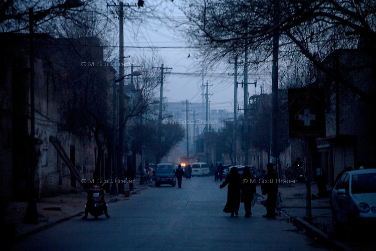Uighurs walk through the Old City neighborhood of Kashgar, Xinjiang, China.