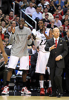 The Bearcats' bench celebrate as they extend their lead over the Tigers. Cincinnati defeated Missouri 78-63 during the NCAA tournament at the Verizon Center in Washington, D.C. on Thursday, March 17, 2011. Alan P. Santos/DC Sports Box
