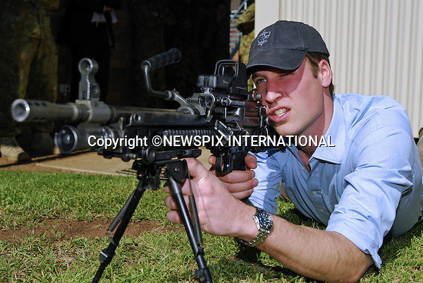 """PRINCE WILLIAM.Prince William visited the 3rd Battalion, The Royal Australian Regiment, Holsworthy Barracks Sydney.The Prince took time to meet 100 soldiers including some who have just returned from active service in Afghanistan. William spent approximately 15 minutes on a live-firing range, where he fired 123 rounds on a F88 Austeyr and a F89 Minimi (the Australian equivalent of a SA80) and also received an Australian infantry hat. Holsworthy Barracks, Sydney, Australia_20/01/2010..Mandatory Credit Photo: ©DIAS-NEWSPIX INTERNATIONAL..**ALL FEES PAYABLE TO: """"NEWSPIX INTERNATIONAL""""**..IMMEDIATE CONFIRMATION OF USAGE REQUIRED:.Newspix International, 31 Chinnery Hill, Bishop's Stortford, ENGLAND CM23 3PS.Tel:+441279 324672  ; Fax: +441279656877.Mobile:  07775681153.e-mail: info@newspixinternational.co.uk"""