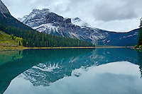 Emerald Peak reflected in the water of Emerald Lake in  Yoho National Park